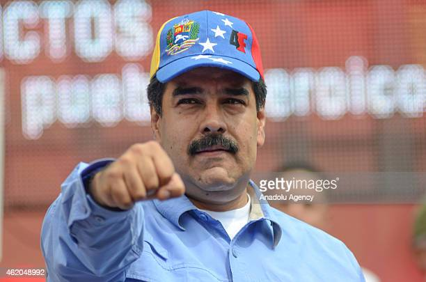 Venezuelan President Nicolas Maduro with his fist up in the air during the 'March of the Undefeated' commemorating the 57th anniversary of the...