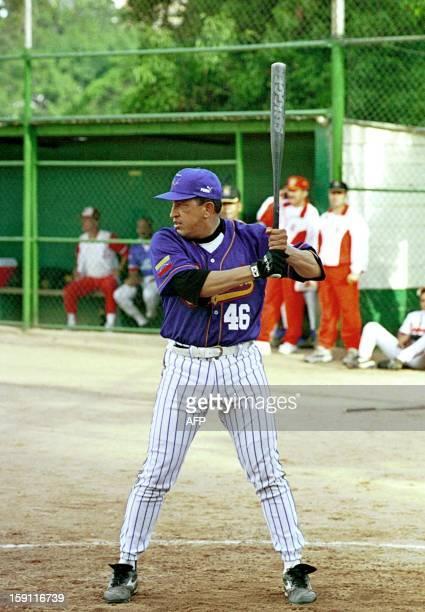 Venezuelan Presient Hugo Chavez Frias bats during a softball game in Caracas 29 August 1999 El Presidente venezolano Hugo Chavez Frias batea durante...