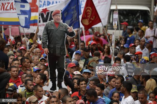 TOPSHOT Venezuelan progovernment activists rally to express their support to the Constituent Assembly in Caracas on August 7 2017 Venezuela's...