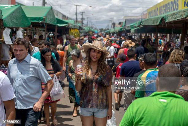 Venezuelan refugee Maria Marchan poses for a picture as she sells beers for a living at a street market in the city of Boa Vista Brazil on February...