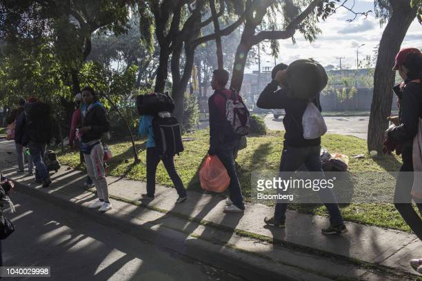 Venezuelan residents arrive at an informal migrant camp in Bogota Colombia on Sunday Sept 9 2018 About 150 Venezuelans have arrived establishing the...