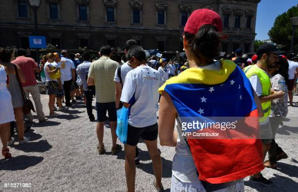Venezuelan residents in Madrid queue to vote during a symbolic plebiscite on president Maduro's project of a future constituent assembly, called by...