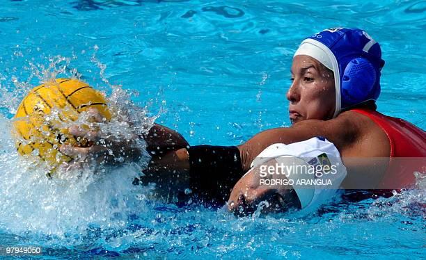 Venezuelan Rocio Galue and Brazilian Flavia Vigna struggle for the ball in women's waterpolo during the IX South American Games in Medellin Antioquia...