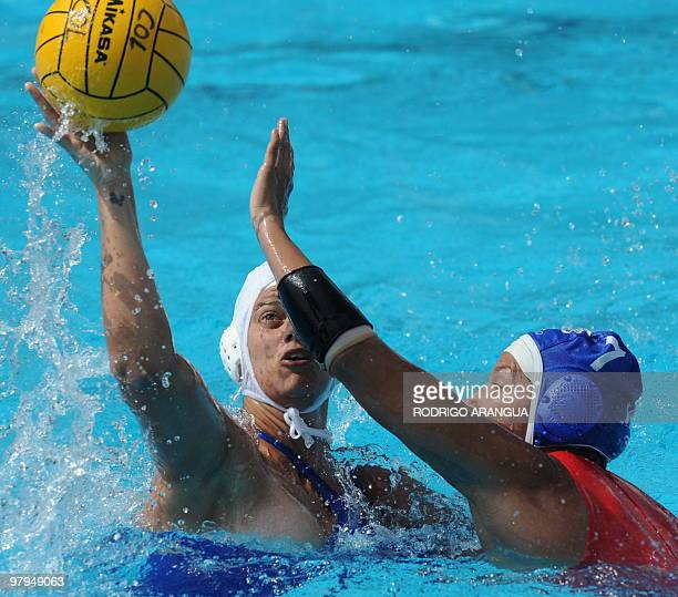 Venezuelan Rocio Galue tries to block Brazilian Flavia Vigna during the women's waterpolo match at the IX South American Games in Medellin Antioquia...