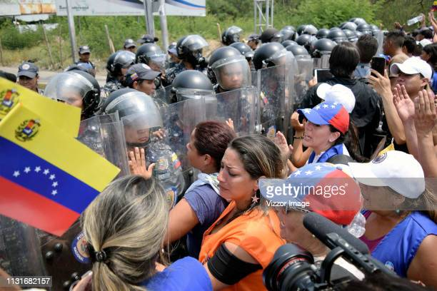 Venezuelan security forces block the passage of supporters of the opposition during the attempt to admit humanitarian aid to Venezuela at the...