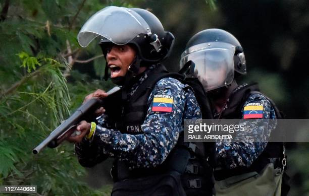 Venezuelan security forces clash with supporters of Venezuelan opposition leader Juan Guaido on the Venezuelan side f the Francisco de Paula...