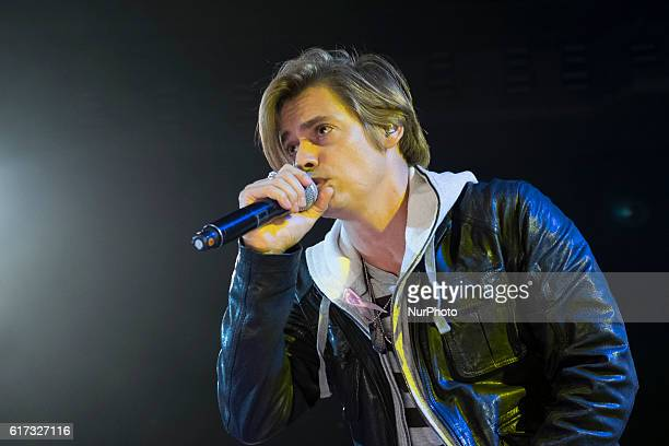 Venezuelan singer Carlos Baute performs on stage during the 'For them' concert at the Sports Palace in Madrid Spain 22 October 2016 The concert was...