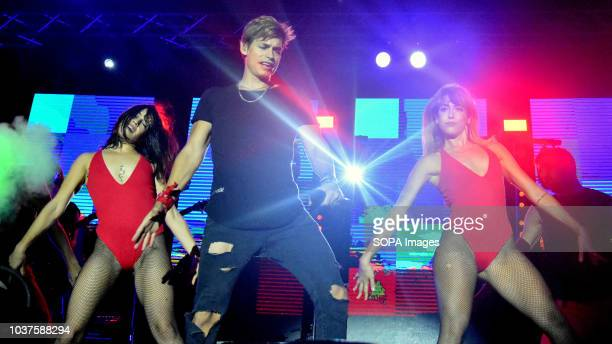 Venezuelan singer Carlos Baute seen performing with dancers during the live concert in the City of Esplugues in Barcelona for the Saint Matthew Day