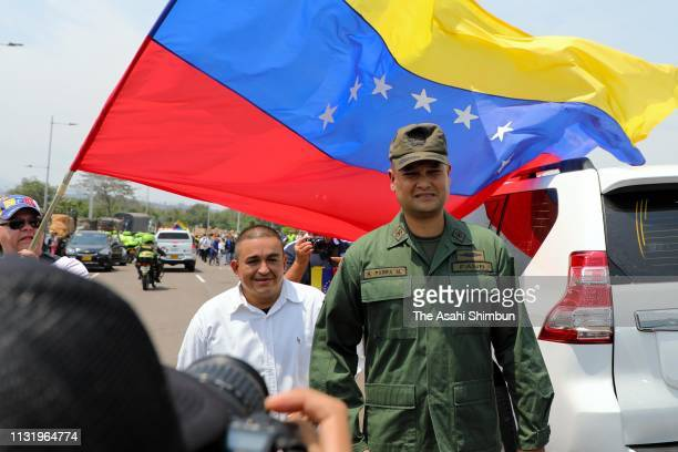 A Venezuelan soldier left the unit and exile is welcomed by Venezuelan people at the Simon Bolivar international bridge on February 23 2019 in Cucuta...