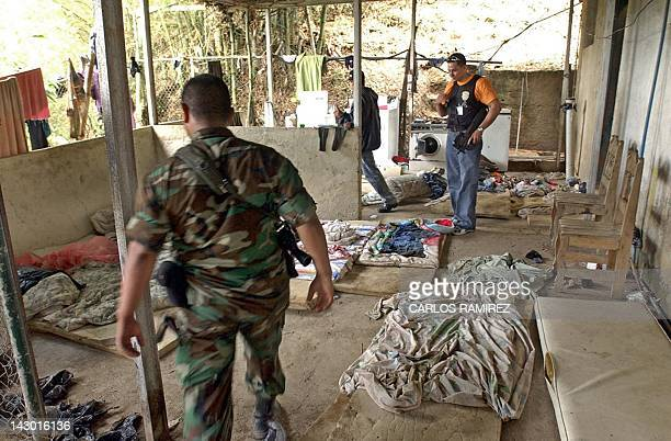 Venezuelan soldiers check the belongings of alleged Colombian paramilitary members after their arrest in Daktari farm east of Caracas 09 May 2004...