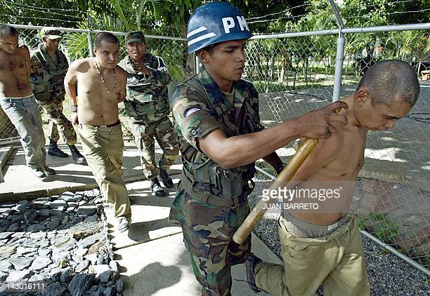 Venezuelan soldiers guard alleged Colombian paramilitary militants in Caracas after their arrest in Daktari farm east of the capital 09 May 2004...
