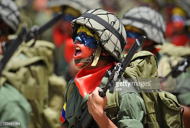 Venezuelan soldiers march during the parade commemorating Venezuela's Bicentennial in Caracas on July 5 2011 Venezuela celebrated the Bicentennial of...