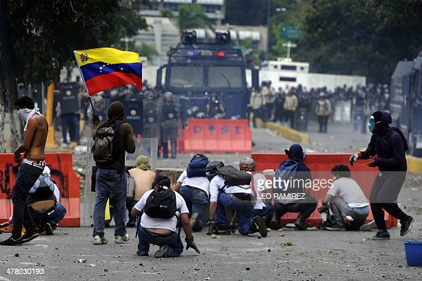 Venezuelan students and activists clash with riot police during a protest against the government of President Nicolas Maduro in Caracas on March 12...
