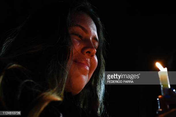 Venezuelan students and other opposition demonstrators hold candles during a vigil at Bolivar Square in Chacao eastern Caracas on February 12 2019...