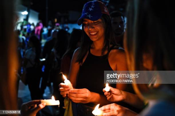 Venezuelan students and other opposition demonstrators light candles during a vigil at Bolivar Square in Chacao eastern Caracas on February 12 2019...