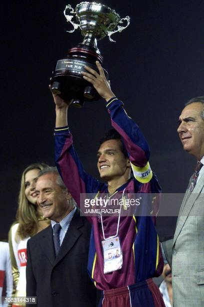 Venezuelan team captain for the SUB 17 soccer selection Evelio Hernandez raises the Faurplay Cup during the closing ceremony of the South American...