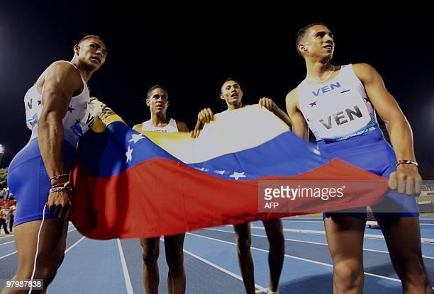 Venezuelan team Geormi Jaramiloo Ruben Headly Arturo Ramirez and Omar Longart celebrate after winning the gold medal in 4 x 400 m relay during the IX...