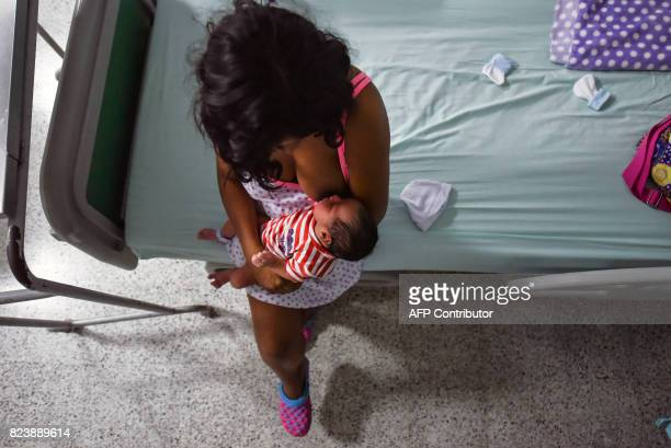 A Venezuelan teenager who migrated to Colombia with a friend three years ago fleeing from her parents violence brestfeeds her newborn Juan David at...