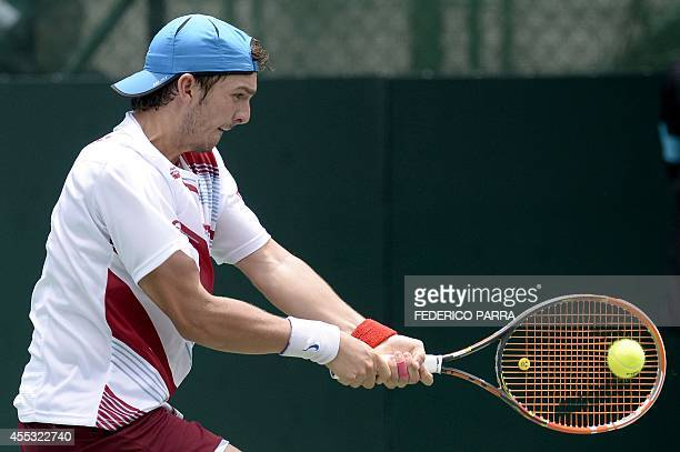 Venezuelan tennis player Jesus Bandres hits a return to Uruguayan Pablo Cuevas, during their Davis Cup American Zone Group I singles match, in...