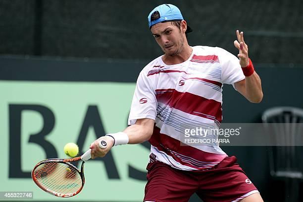 Venezuelan tennis player Jesus Bandres hits a return to Uruguayan Pablo Cuevas during their Davis Cup American Zone Group I singles match in Caracas...