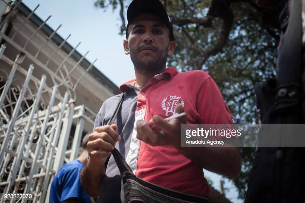 Venezuelan trying to survive and escape from his country crisis sells candies as he receives food at a charity churches in ColombianVenezuelan Border...
