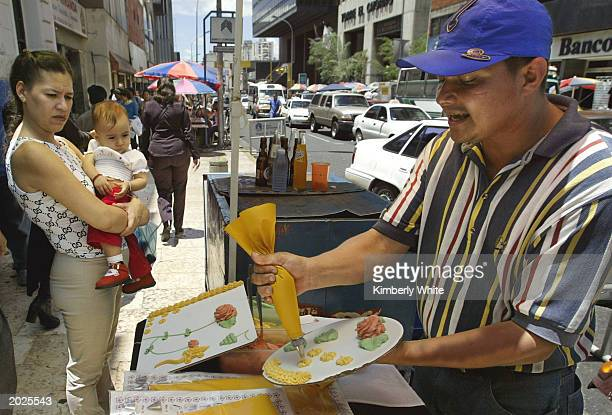 Venezuelan vendor sells cake decorations on the street May 21 2003 in Caracas Venezuela The Central Bank reported May 23 2003 Venezuela's economy is...