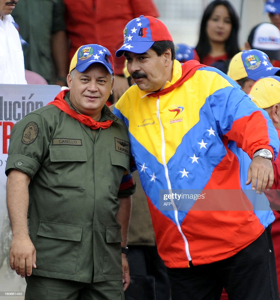 Venezuelan Vice President Nicolas Maduro (R) and the president of the National Assembly, Diosdado Cabello (L) wave during the conmemoration of the 1992 failed coup led by Hugo Chavez, who was an army lieutenant colonel, against then president Carlos Andres Perez, in Caracas, on February 4, 2013. Ailing President Hugo Chavez, who had cancer surgery in December, is doing much better and recovering, Cuban leader Fidel Castro said in remarks published Monday. AFP PHOTO/Leo RAMIREZ AFP PHOTO/ Leo RAMIREZ