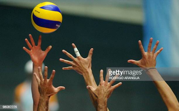 Venezuelan volleyball players compete with Argentine during the IX South American Games in Medellin Antioquia department Colombia on March 24 2010...