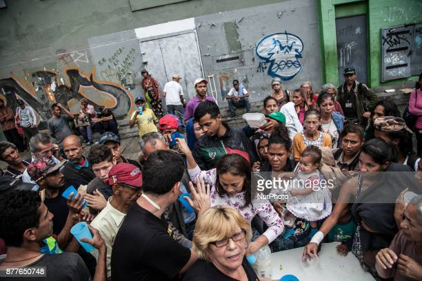 Venezuelan wait in a food distribution long queue in Caracas Venezula on 23 November 2017 Venezuel people lives between the alert crisis and...