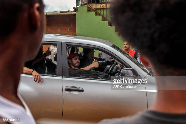 Venezuelan WBA lightweight World Champion Jorge Linares gives his thumb up during a charity visit to La Honda neighbourhood in Medellin Colombia on...
