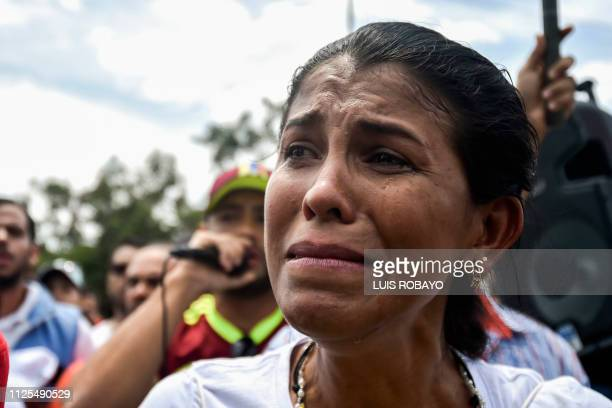 A Venezuelan woman cries while singing the national anthem during the visit of US senator Marco Rubio at the Simon Bolivar international bridge in...
