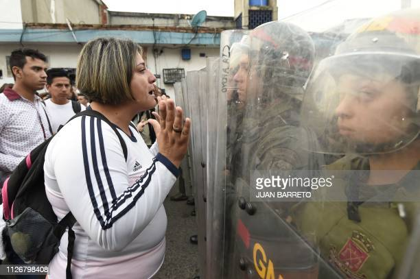 A Venezuelan woman talks to national guards as they block the access to the border in th Venezuelan town of Ureña after Maduro´s government ordered...