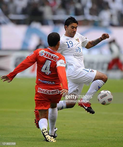 Venezuelan Yaracuyanos' player Juan Pendola vies for the ball with Ecuadorean Liga de Quito's Claudio Bieler during their Copa Sudamericana football...