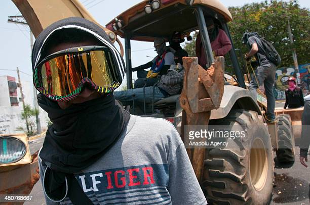 Venezuelan youths take part in an antigovernment protest on March 26 2014 in Maracaibo Venezuela The death toll from protestrelated violence in...