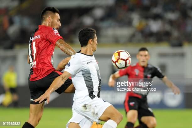 Venezuelan Zamora's Cleiderman Osorio vies for the ball with Argentinian Colon's Marcelo Correa during a Copa Sudamericana football match in Barinas...