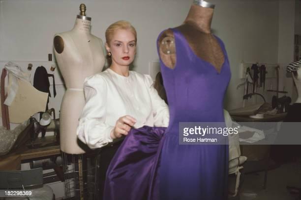 Venezuelan-American fashion designer Carolina Herrera at work in her East 57th Street studio, New York City, May 1987.