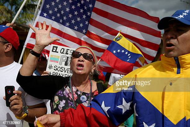 Venezuelans and their supporters show their support for the antigovernment protests in Venezuela as they wait for President Barack Obama to arrive at...
