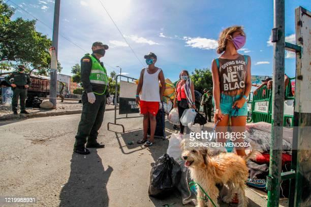 Venezuelans are being transferred from the Simon Bolivar international crossing point to the Tienditas International Bridge where they will be housed...
