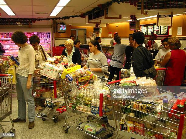 Venezuelans are buying food in bulk December 5 2001 at a Caracas supermarket in Venezuela Consumers are taking precautions due to a possible December...