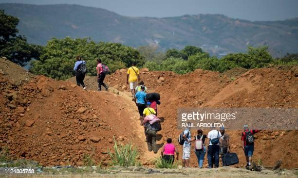 Venezuelans cross from their country through Trochas illegal trails near the Simon Bolivar International Bridge in Villa del Rosario Norte de...