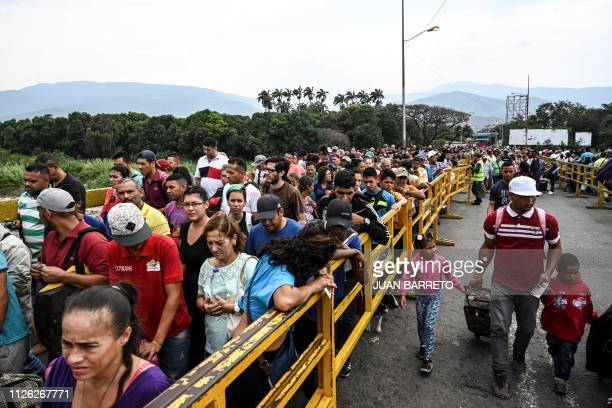 Venezuelans cross the Simon Bolivar brige in San Antonio del Tachira Tachira State Venezuela on the border with Colombia on February 20 2019 Nicolas...
