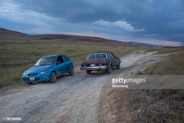 Venezuelans drive vehicles back after collecting supplies near the Venezuelan border in Pacaraima, Brazil, on Wednesday, April 10, 2019. Venezuelan...