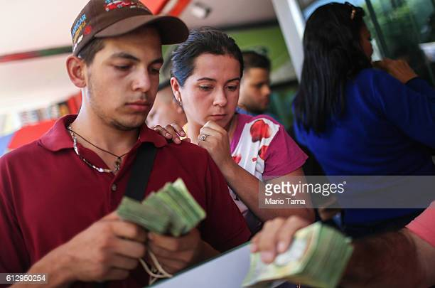 Venezuelans exchange bolivars the currency of Venezuela into Colombian pesos in order to purchase Colombian goods on October 4 2016 in Cucuta...