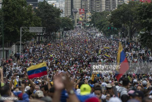Venezuelans gather for a mass rally against Nicolas Maduro in Caracas Venezuela on January 23 2019 President Donald Trump recognized Juan Guaido...