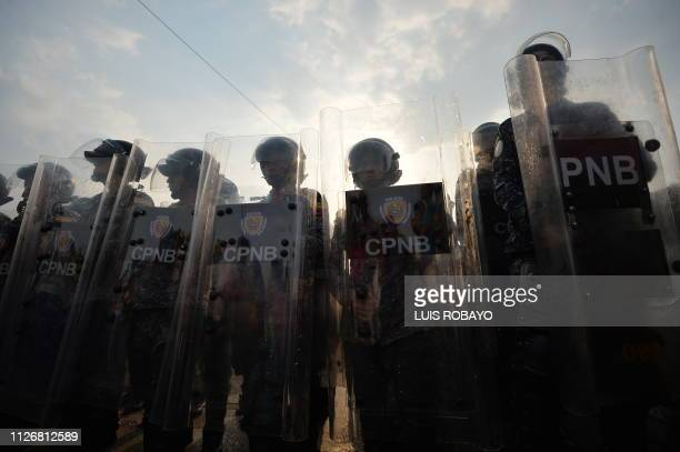 TOPSHOT Venezuelans national policemen stand guard at the Simon Bolivar bridge in Cucuta Colombia after President Nicolas Maduro's government ordered...