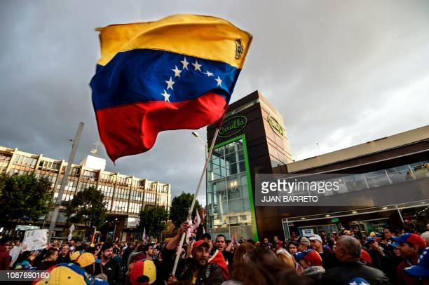 Venezuelans opposed to President Nicolas Maduro hold a demonstration in Bogota Colombia in support of opposition leader Juan Guaido's...