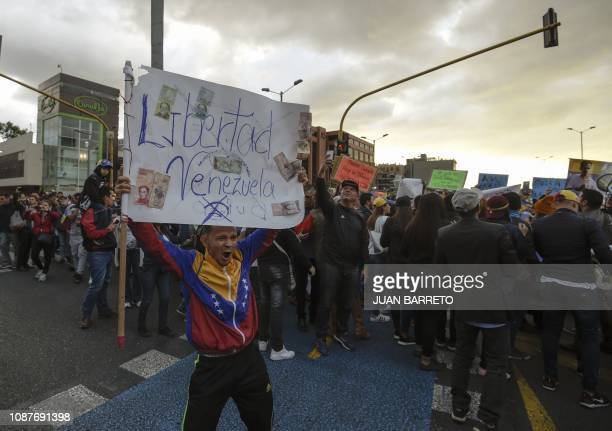 TOPSHOT Venezuelans opposed to President Nicolas Maduro hold a demonstration in Bogota Colombia in support of opposition leader Juan Guaido's...