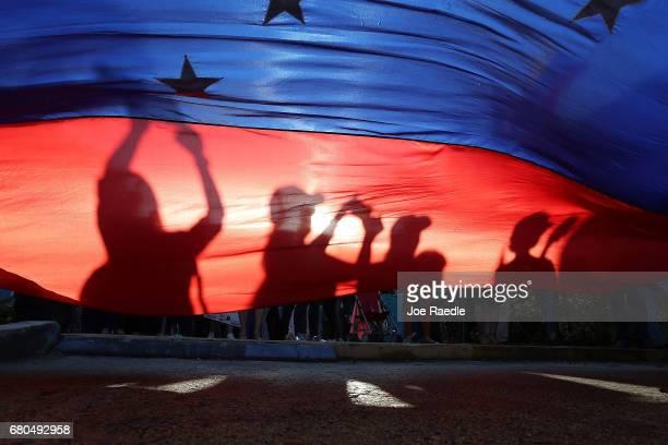 Venezuelan's protest against the Venezuelan government as Florida Governor Rick Scott hosts a Venezuelan Freedom Rally at El Arepazo 2 to show his...