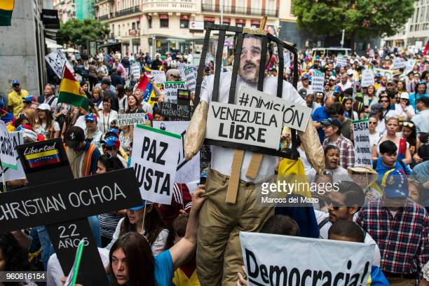 Venezuelans protesting against Nicolas Maduro as presidential elections take place in their country