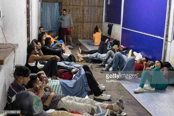 Venezuelans rest after several hours of walking in a refuge of the Samaritans Purse Foundation Venezuelan migrants rest as they walk on the road from...